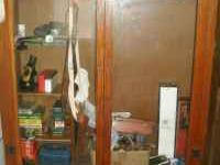 We are selling a nice wood gun cabinet with glass doors