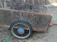 For sale is a wood with metal frame hauling cart for