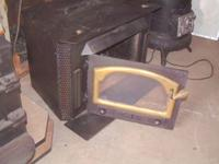This Buck Fireplace Insert wood stove is in good used