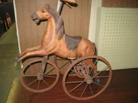 This is vintage. - A carved wooden painted body with