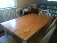 I have a wooden kitchen table for sale for $200.00.