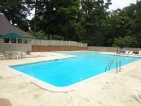 : Wood lot in lake acess subdivision with swimmingpool