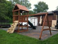 Sturdy wood playground. Fort has steering wheel and