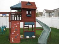 Wood Playset in good condition. Includes 2 swings and