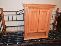 We have a Wood Pro Solid Oak Cabinet that we were not