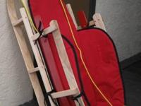 -- Wooden sled made by L.L. Grain, asking $50.00. --