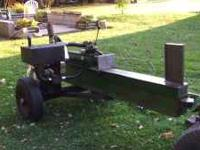 Wood Splitter with 5hp briggs and 2 stage pump. Solid