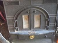 dutchwest india wood stove / with a fan . In good
