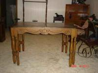 Solid wood table. Has ornate legs. I think the year is