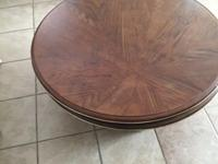 Large wood swivel table. Sturdy and heavy. There are a
