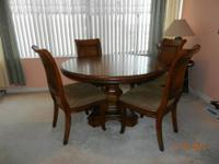 WOOD TABLE & FOUR CHAIRS.OAK COLOR .GOOD CONDITION.