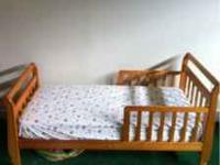 I am selling a honey wood toddler bed previously