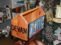 Rustic wood device box covered with Vintage license