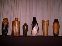 Set of 6 ornamental solid wood vases. Numerous designs,
