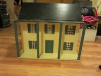 Wooden victorian doll house full of furniture and