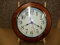 This is a nice wood framed wall clock with quartz