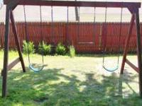 Wooden swingset for sale. Made of treated lumber and is