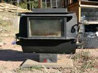 "Freestanding woodstove, takes up to 18"" logs. Used last"