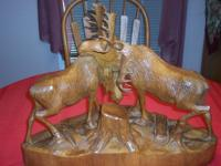 Beautiful wood carving of 2 fighting bull moose all