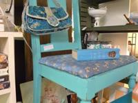 Vintage chair painted aqua color and distressed for age