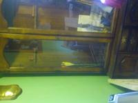 Beautiful wood gun cabinet. Glass doors and a lot of
