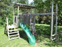 Wood swing set: 1st area has actually set of rings and