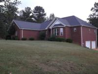 This beautiful 5 BD, 31/2 BA brick home located on 4