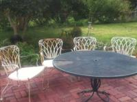 Woodard wrought iron patio table and chairs need a