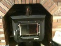 FORGE wood burning stove- like new less than cord of