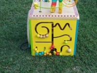 Parents/Battat Wooden Activity Cube gently played with