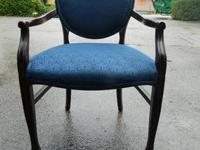 We are selling a used Wooden Arm Chair. It has a nice