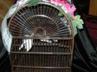 This antique looking wooden bird cage was used for 2