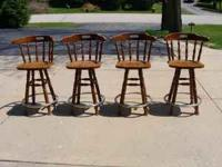 I have four wooden swivel style bar stools for sale. I