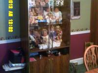 I have a wooden cabinet I used to display my dolls in.