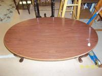Very nice wooden coffee table. Mahogany color. $20.00