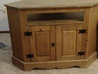 Wooden corner cabinet. Open back, with holes for