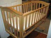 We have a wooden cradle with wheels for sale. We used