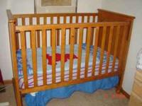 A wooden crib in very good condition with
