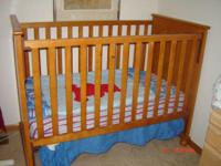 Description Awooden crib in very good condition bought