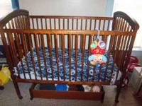 I have a like new wooden crib for sale. Crib is in
