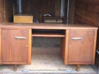 Wooden desk with locking doors. Finished on all sides.