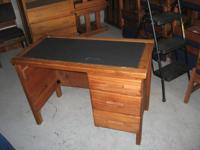 I have a wooden desk with 3 drawers for sale for $50.