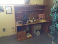 I am selling a wooden desk with built in shelving. It