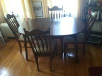 Wood dining room table with laminate wood-like top.