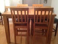 Selling a wooden 4-person dining table (that can be