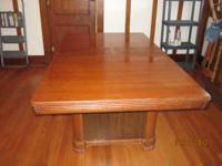 Wooden dining room table. Has been in our family for