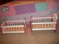 Pink and white wooden doll beds. Good condition. $50