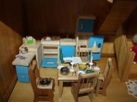 Up for sale is a LOVELY wood doll-house. It was stained