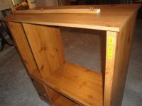 Selling a wooden entertainment center. Left leg needs