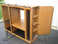 "Wooden Entertainment Center for sale. 48"" high x 59.5"""